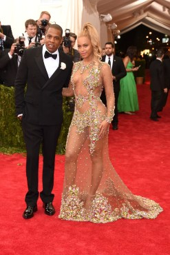 Jay-Z and Beyoncé (power couple), who wore a Givenchy Haute Couture by Riccardo Tisci dress.